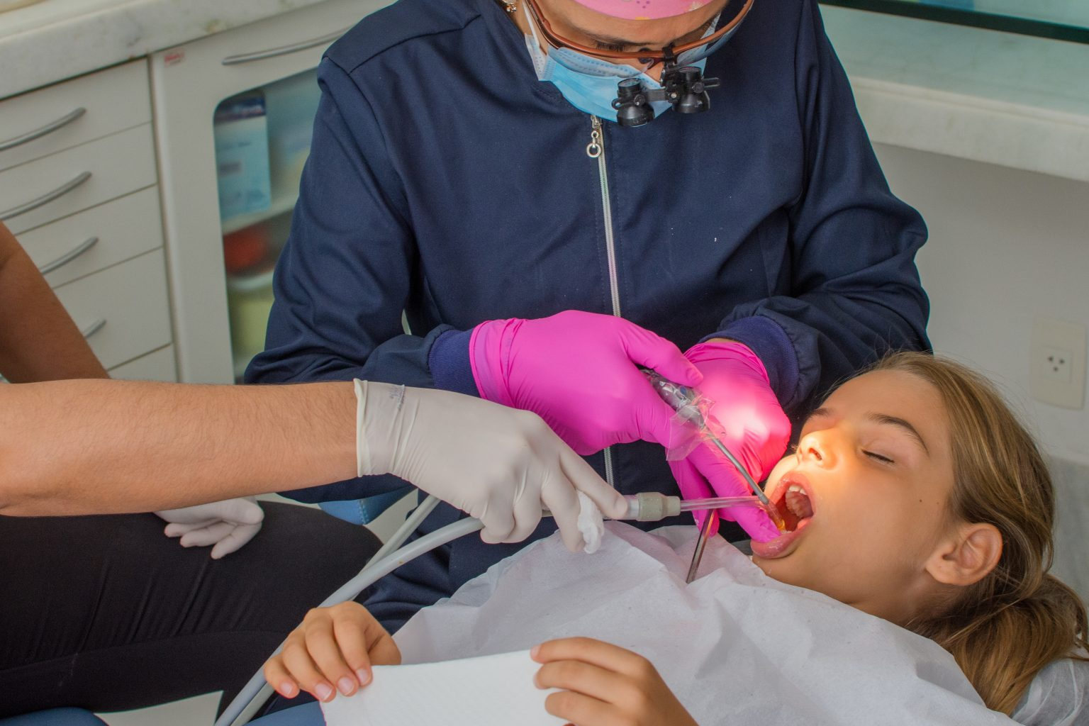 Child Girl In Specialized Dental Treatment As Routine